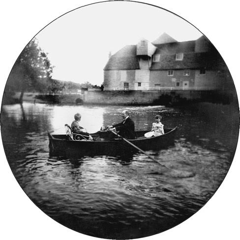 Undated. Alfred North Whitehead rowing on the pond at the Mill House in Grantchester, Cambridges